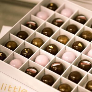 chocolate pralines inside a 36 piece white gift box