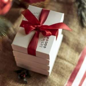 gift box of chocolates with ribbon under the Christmas tree