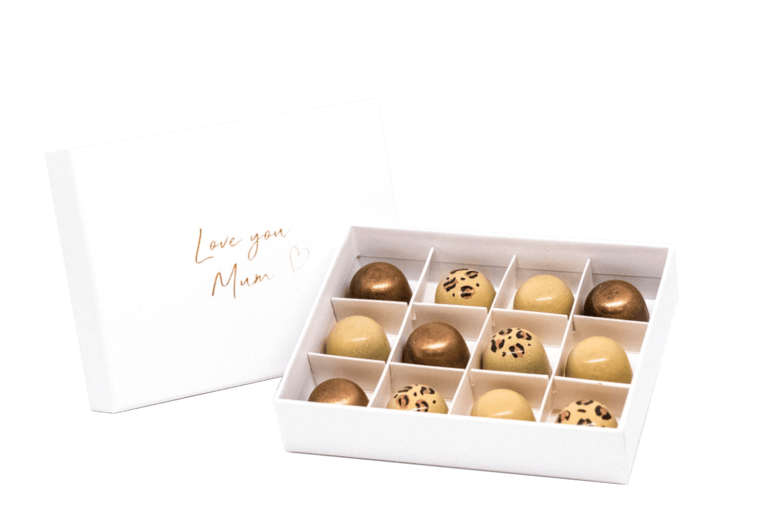 Twelve pralines in a Mother's Day gift box embossed in gold foil that says 'Love you mum!'