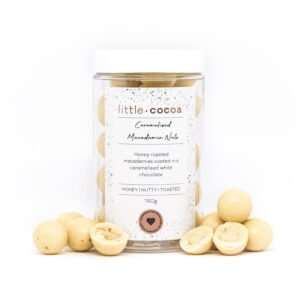 macadamia nuts coated in a caramelised white chocolate, sitting in a clear jar