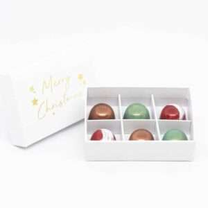 merry christmas gift box with six festive chocolate pralines